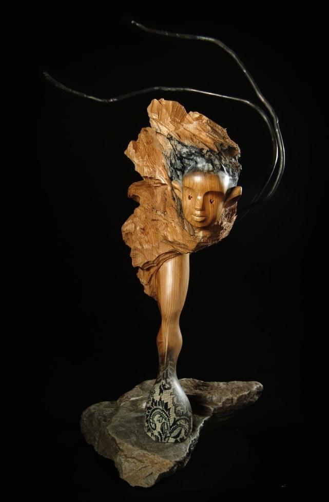Collection: L'allégorie des ambiguïtés, Noyer cendré, tiges d'acier, pierre-Photo: Benoît Lemay